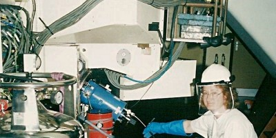 Sheila Crosby filling an instrument with liquid nitrogen in the Isaac Newton Telescope in 2003, with protective clothing.