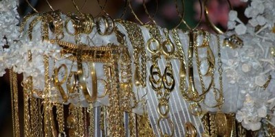 Detail of a cross decorated with jewellry for Fiesta de La Cruz, Breña Baja