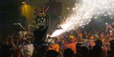 Wire frame dragonfly, with lit fireworks wooshing sparks El Borrachito fiesta, Mazo, La Palma