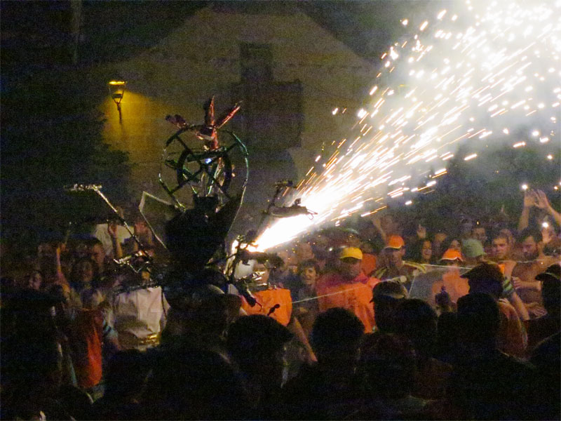 Wire frame dragonfly, with lit fireworks wooshing sparks El Borrachito fiesta, Mazo, La Palma