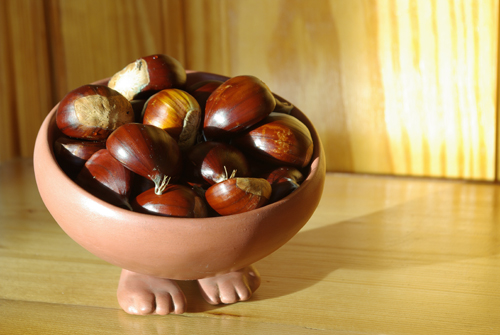 chestnuts in a bowl with legs