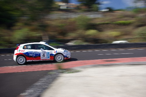 Rally car zooming through San Jose, Breña Baja