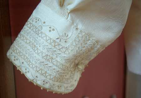 Fine satin stitch on a cuff in the embroidery museum, Mazo, La Palma