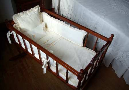 A cradle full of embroidered silk in the embroidery museum, Mazo, La Palma