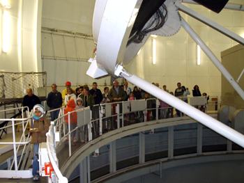 Visitors looking at the top of the William Herschel Telescope