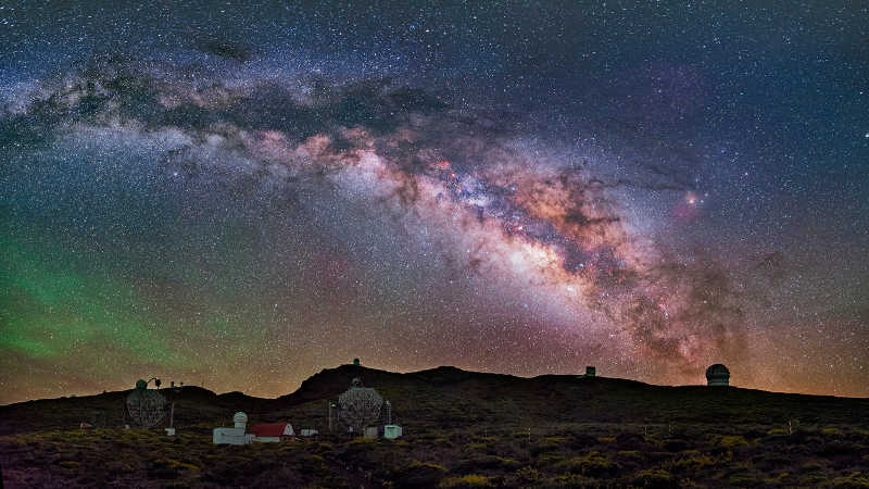 The observatory at the Roque de Los Muchachos at night. Credit: Daniel Lopez. ASCII Kolor stitching   4 pictures   Size: 8667 x 4915   FOV: 120.27 x 68.20 ~ 24.43   RMS: 2.75   Lens: Standard   Projection: Spherical   Color: LDR  