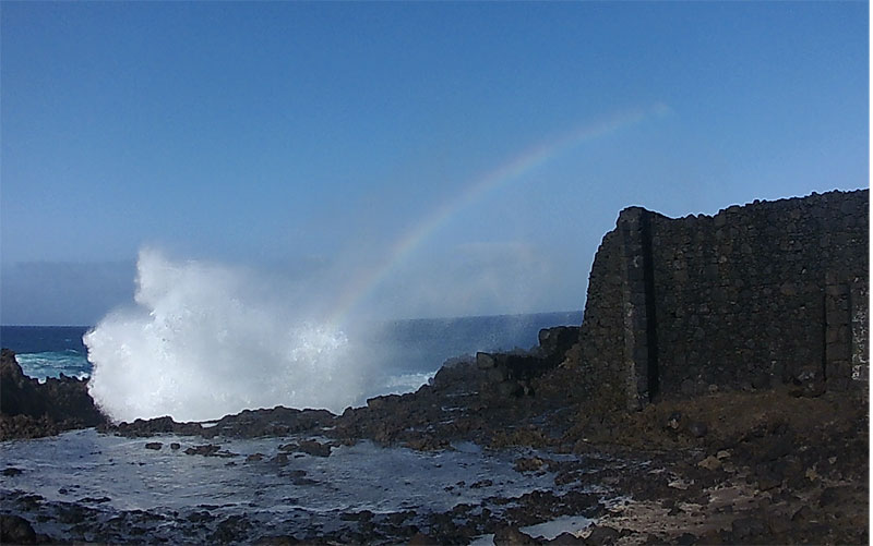 The old water pump for the salt works, Los Cancajos, Bre;a Baja, with a huge wave and a rainbow in the spray.