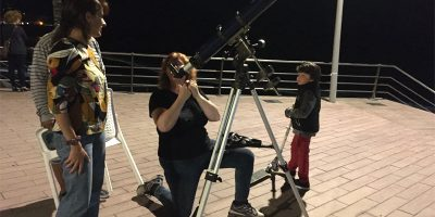 Sheila Crosby setting up a telescope at Puerto Naos,