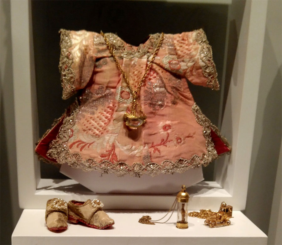 Some of Baby Jesus's heavily embroidered clothes, Sacred Museum, Las Nieves, La Palma island