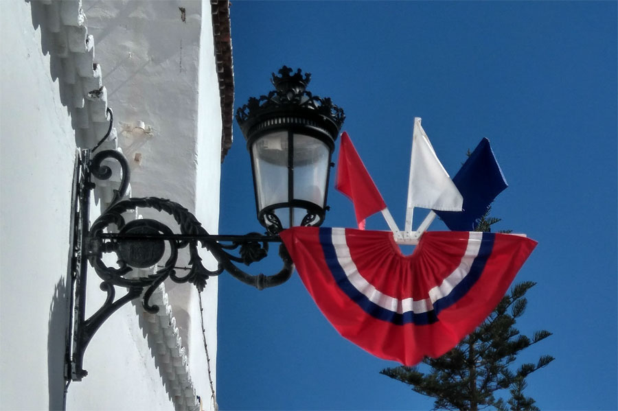 Old fashioned street light and a flag for fiesta de la cruz, Santa Cruz de La Palma