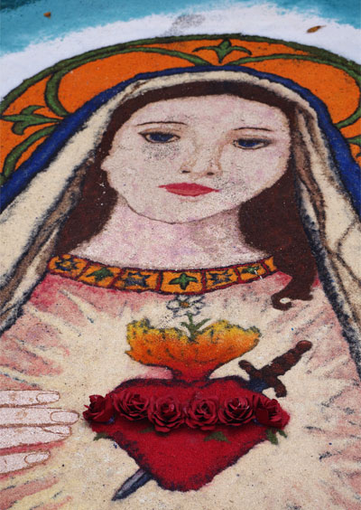 A portrait of the Virgen Mary made from coloured salt.
