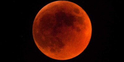 The Moon blood red because it's completely inside the Earth's shadow.